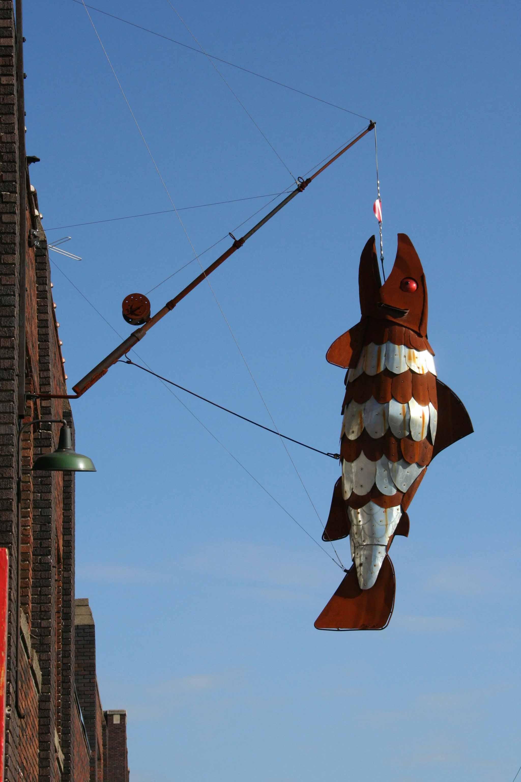 large 3D metal fish sculpture installation