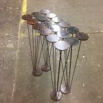 lilypad steel console table acid etch texture